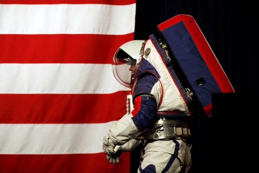 Advanced Space Suit Engineer at NASA Kristine Davis wears the xEMU prototype space suit for the next astronaut to the moon by 2024, during its presentation at NASA headquarters in Washington, U.S., October 15, 2019. REUTERS/Carlos Jasso